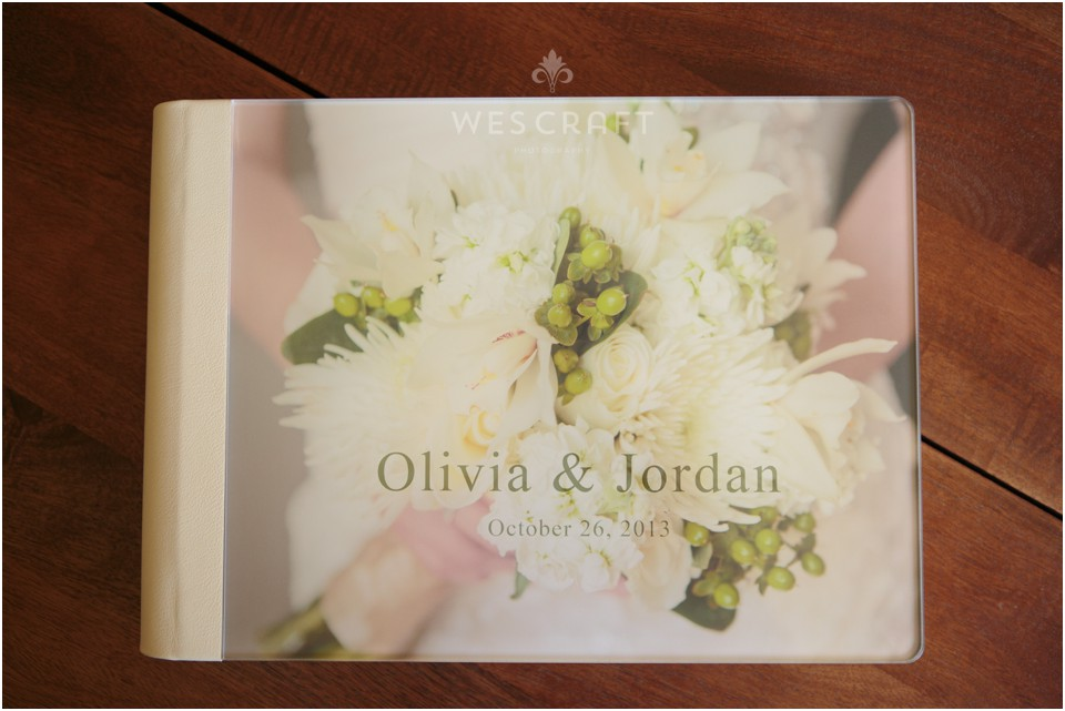 Olivia chose to have a detail of her bouquet as the cover photo.  The photo is sealed beneath an acrylic and is bound with an Ivory Italian Leather.
